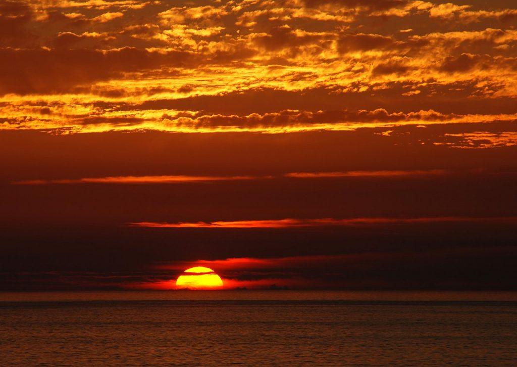 Sun sinking below the horizon debunks flat Earth.
