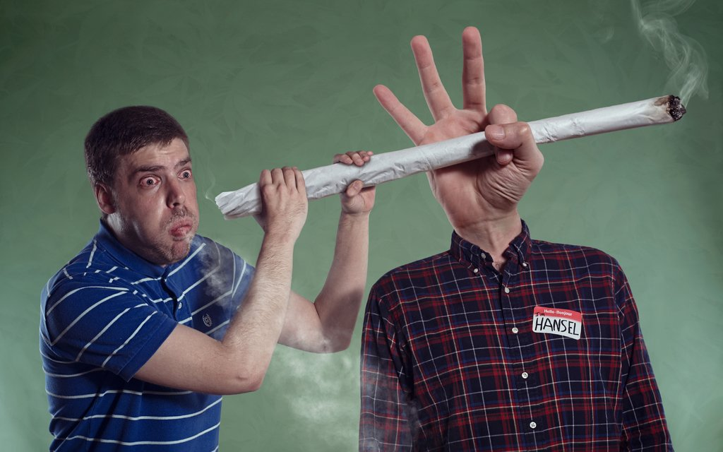 Man smoking a comically-large joint.
